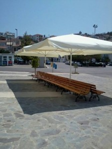Finally benches and umbrellas at the port of Poros